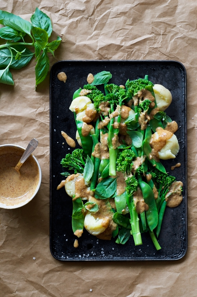 Magic Miso Almond Sauce on Steamed Greens and New Potatoes | Immune boosting probitioc and prebiotic almond butter and miso sauce! Super tasty and easy alternative to satay. Vegan, quick, gluten free