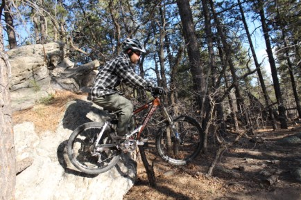 A freerider hitting a jump on the Dalla Mountain Freeride Trail. Don't let the City of Durango destroy this trail!