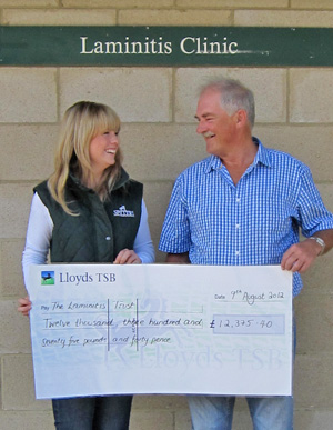 Robert Eustace, founder of the Laminitis Trust, receives a cheque from Spillers representative Rachel Austin.