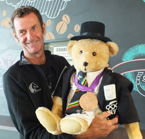Mark Todd with the teddy bear being auctioned for charity.