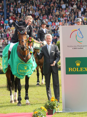 Rolex Grand Prix winners Nick Skelton and Big Star receive their prize.
