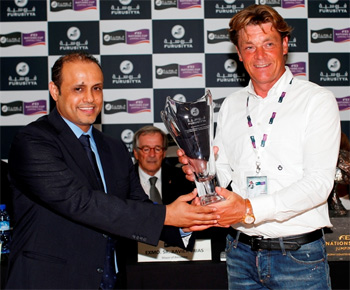 Jeroen Dubbeldam, right, receives the Furusiyya Rider of the Final award from Saudi Equestrian Team Director Sami Al Duhami.