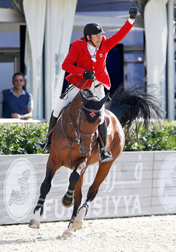 Eric Lamaze celebrates his double clear with Powerplay to earn a half share of the €200.000 bonus on offer at the Nations Cup competition.