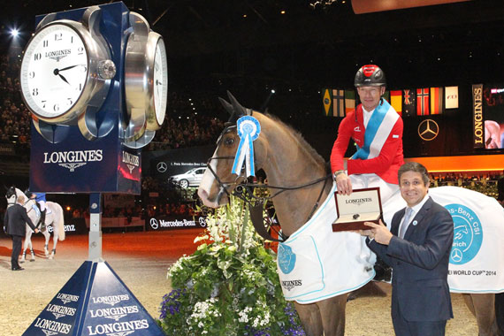 Longines Head of International Marketing Juan Carlos Capelli presents Pius Schwizer with a Longines watch after the Swiss rider, riding Toulago, won the World Cup leg at Zurich, Switzerland at the weekend.