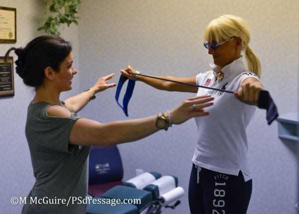 Dr. Anais Maristany helps Silvia Rizzo with exercises to improve her back health.