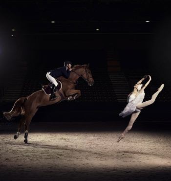 US rider Charlie Jacobs demonstrates the power and athleticism of his sport, alongside Liudmila Khitrova from the Minsk Bolshoi, ahead of the Longines FEI World Cup Jumping Final.