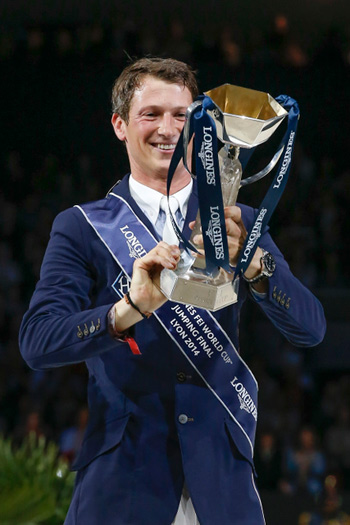 Germany's Daniel Deusser looks with delight at the Longines FEI World Cup Jumping trophy which he won on Monday following a superb performance with Cornet d'Amour.