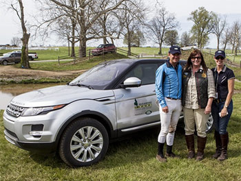 Phillip Dutton and wife, Evie, (center) accept the keys to a 2014 Range Rover Evoke from Kim McCullough, the Land Rover of North America vice president for branding.