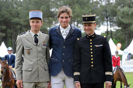Saumur 3* winner Maxime Livio, centre, with Donatien Schauly and Thibault Valette.