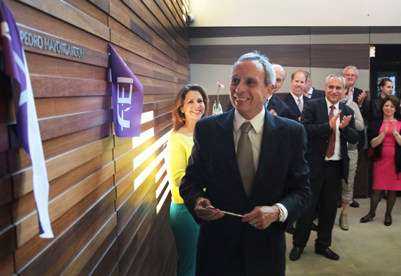 FEI 2nd Vice-President Pedro Mayorga cut the ribbon during the inauguration ceremony of the FEI Headquarters conference room dedicated to his late father, Pedro Oscar Mayorga, who was the longest serving FEI Bureau member.