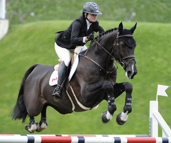 Tiffany Foster guided Tripple X III to a second-place finish behind Eric Lamaze and Powerplay in the $85,000 1.55m Spectra Energy Cup on June 5 at the CSI5* Spruce Meadows 'National' tournament in Calgary, Canada.