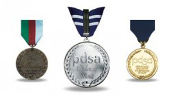 The PDSA Order of Merit, centre, joins the Dickin Medal, left, and the Gold Medal.