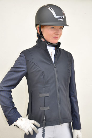 """Dressage rider Zoe Sleigh, who is pictured wearing the Helite Air Shell Gilet over her tailcoat, said: I like the design of the Gilet and it's great that air jackets are becoming more popular with dressage riders."""""""