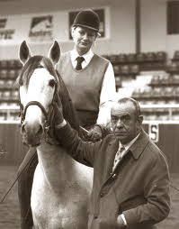 Equestrian master Nuno Oliveira with a student.