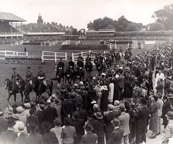 Crowds enjoy a grand parade at an early Dublin Horse Show.