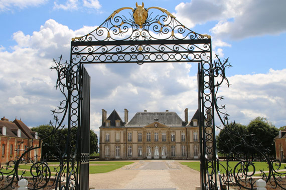 """The magnificent entrance to """"Haras du Pin"""" - the French National Stud."""