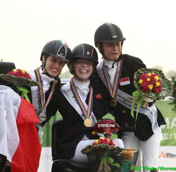 British Grade Ia gold medalist Sophie Christiansen is flanked on the podium by Sarah Morganti and Laurentia Tan.