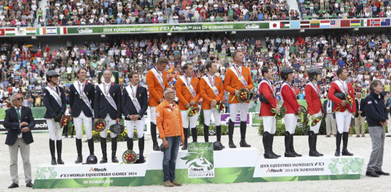 The Dutch team stands victorious on the jumping podium, with silver medalists France, left, and bronze medal winners USA.