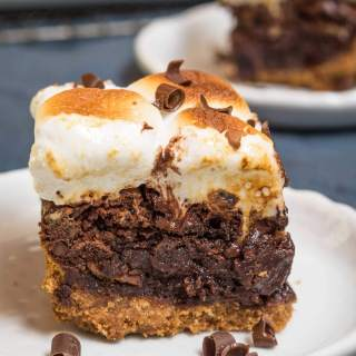 Thick Fudgy S'mores Recipe may look like a hot mess, but they are a big chocolatey bite of heaven. They are quick, easy, and delicious! | HostessAtHeart.com