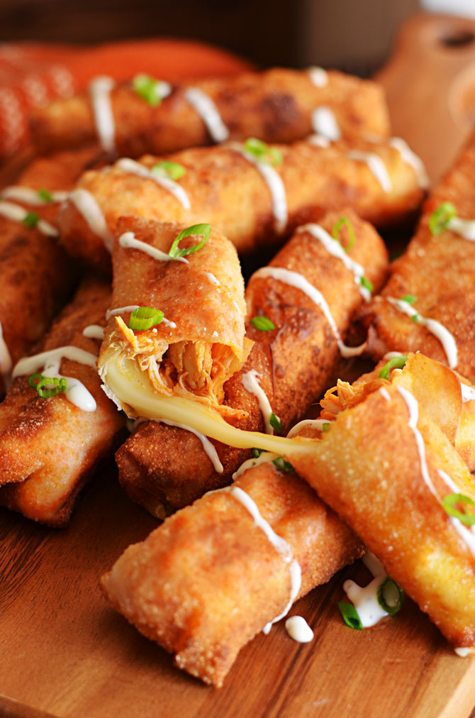 Buffalo Chicken Mozzarella Logs.  This mash-up of everybody's favorite appetizers (wings, mozzarella sticks, and egg rolls)  is just begging to be made for the Super Bowl. | hostthetoast.com