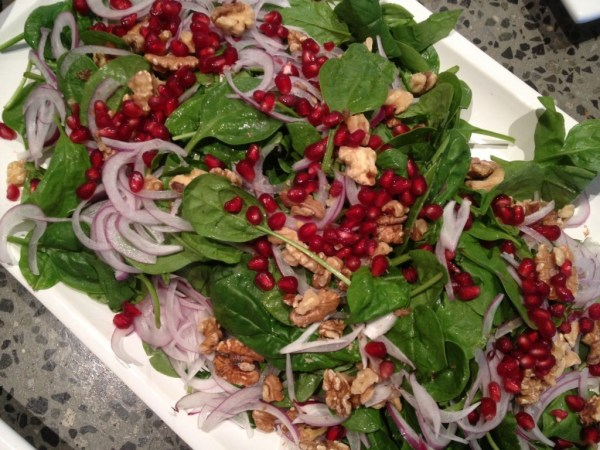 Salad of baby spinach, Spanish onion, toasted walnuts and pomegranate seeds