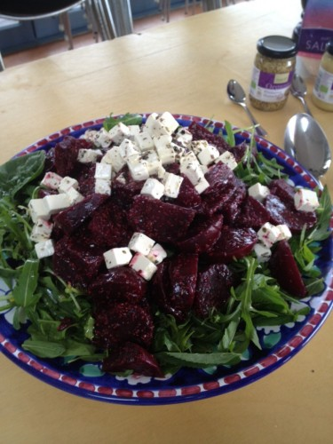 Roasted beetroot salad on a bed of rocket with marinated feta
