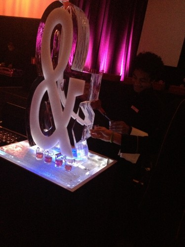 The ice sculpture with the vodka and cranberry cocktails