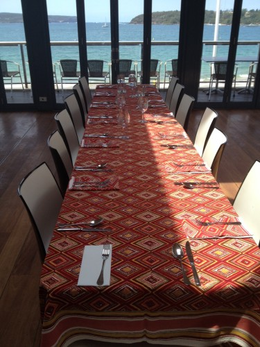 The table in front of the beautiful blue view