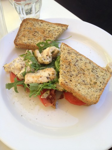 Gluten-Free toasted sandwich with chicken, tomato, avocado, rocket and caramelised onions