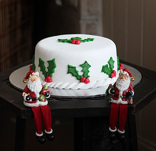 A Christmas cake decorated with holly