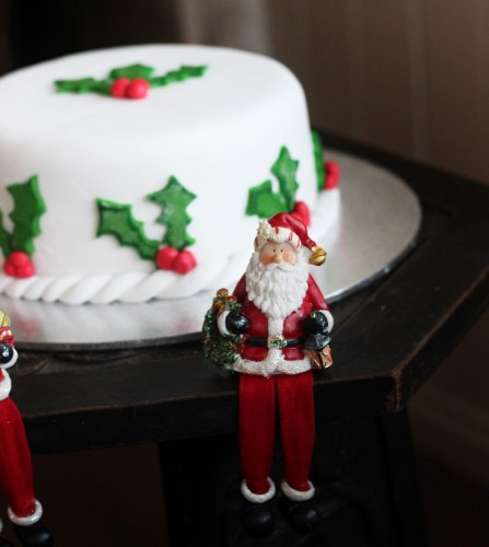 A Christmas Cake guarded fiercely by Santas