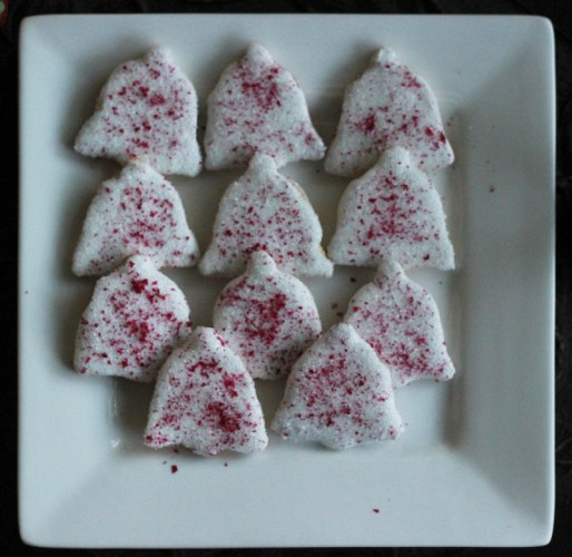 Christmas Bells.  Covered in white icing then sprinkled with edible red glitter