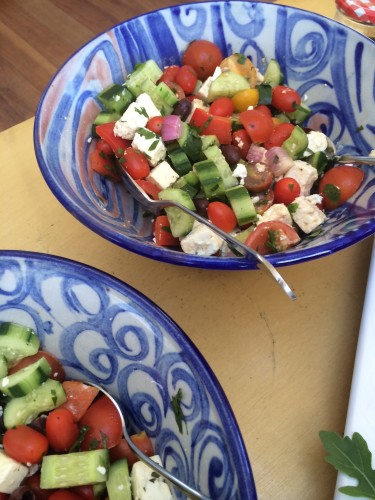 Greek salads in the bowls made by my auntie
