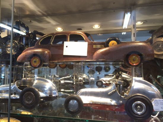 A toy pull-along car made in the Depression