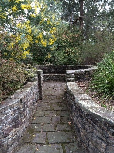 Sandstone paths and walls lead to peaceful places to sit