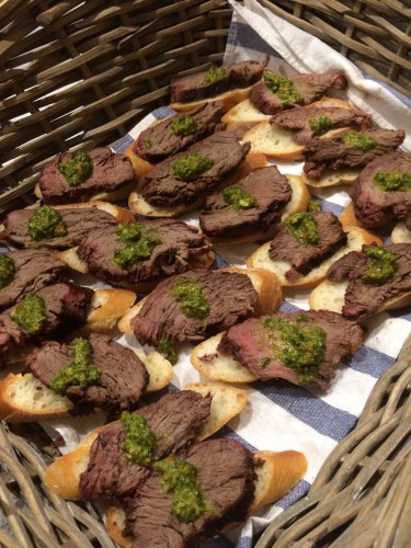 Eye fillets served in baskets with chimmichurri sauce