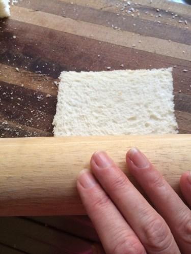 Rolling the bread to flatten it a little