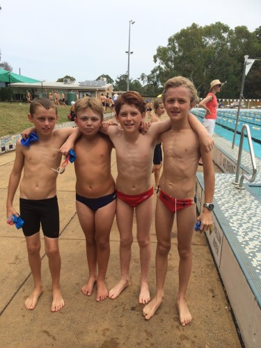 Alfie in the relay team at the swimming carnival