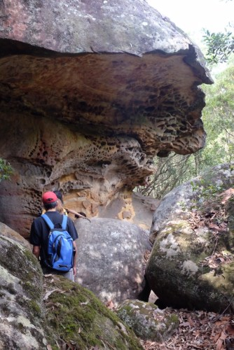 Walking under a rock cliff
