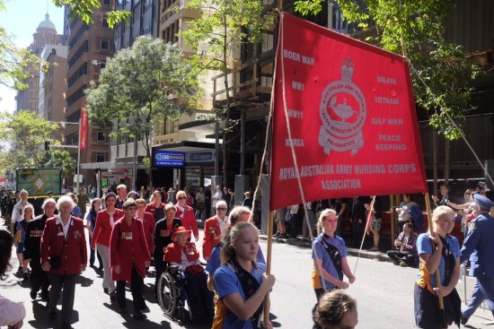 Nurses being led on by Girl Guides