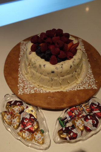 White Chocolate Bombe with berries and chocolates
