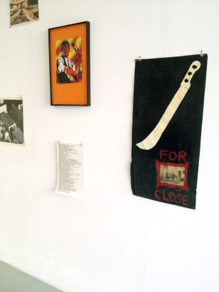 Robert Cooney's machete painting, and Walter Robinson's spray stencil of a brawler with a broken bottle.