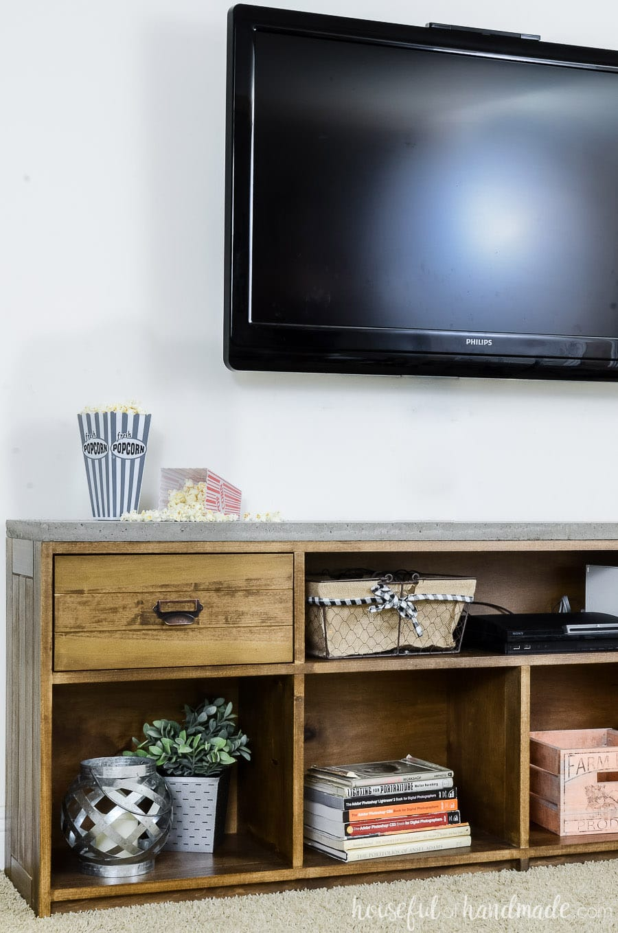Glancing Televison Mounted On Wall Above A Warm Brown Rustic Tv Stand Withconcrete Rustic Tv Stand Handmade Rustic Tv Stands Diy Rustic Tv Stands Target Concrete Houseful houzz 01 Rustic Tv Stands