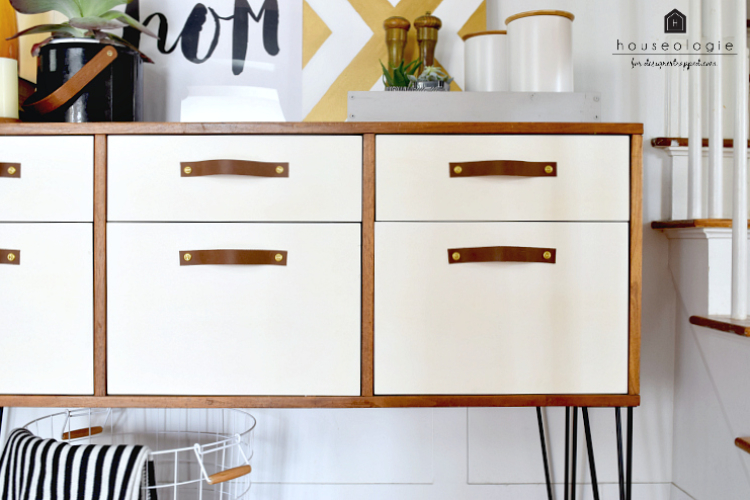 This Mid0century Modern credenza was being supported by squat little legs and had a neglected stain finish. She added hairpin legs, white paint to the drawers and DIY leather drawer pulls. Now it's STUNNING!