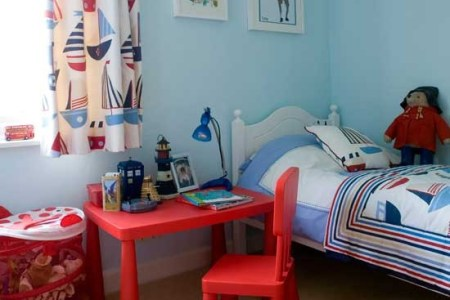 nautical boys' bedroom with bright red desk | boys bedroom