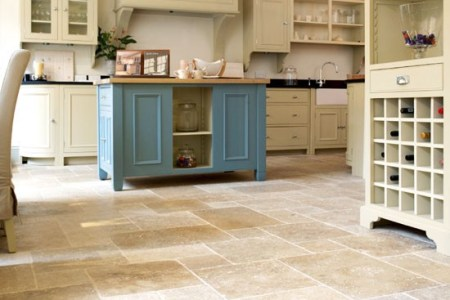 clic pale kitchen with stone floor tiles