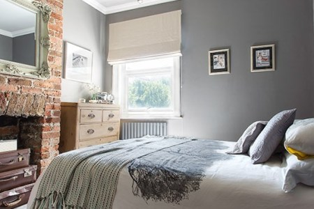 grey bedroom with brick fireplace | 20 gorgeous grey