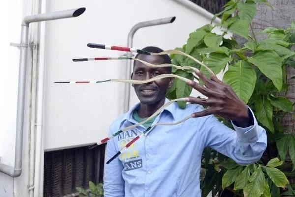 john-waweru-man-longest-nails-africa-photos