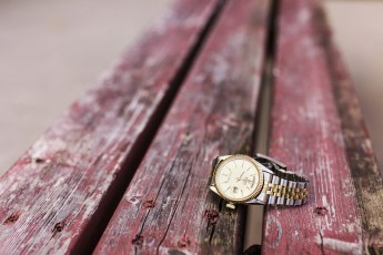 Writs watch on a worn out old bench