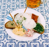 Plate with typical bavarian snacks and beer --- Image by © Royalty-Free/Corbis